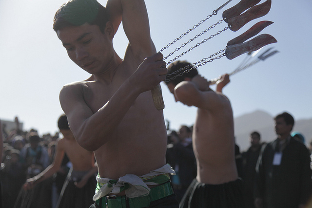 Afghan men use knives to whip their backs on Ashura, the tenth day of Moharram, to mark the death of Imam Hussein.